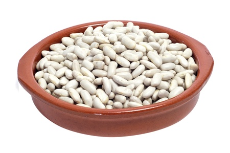 common bean: an earthenware bowl with dry white beans on a white background