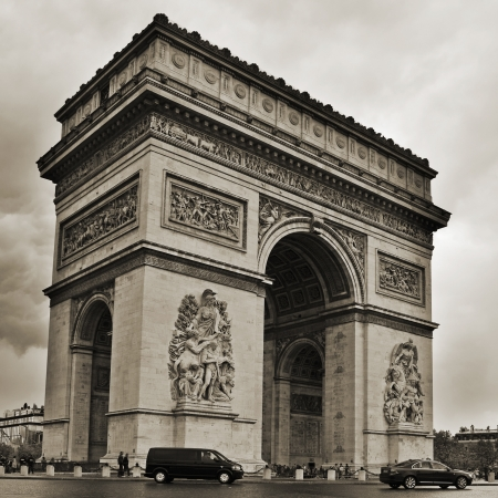 Paris, France - May 16, 2013  The Arc de Triomphe in Paris, France  Located in the center of the Place Charles de Gaulle and inspired by the Roman Arch of Titus, is one of the most famous monuments in Paris