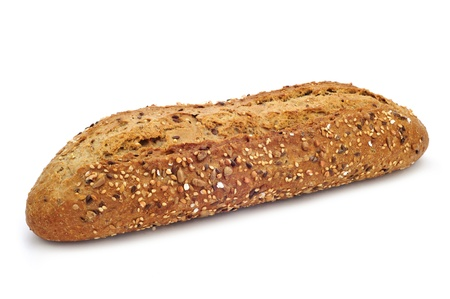 closeup of a brown baguette topped with different seeds, such as sesame and poppy seeds, on a white background Foto de archivo