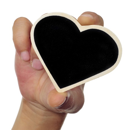someone holding a heart-shaped blackboard in his hand a white background photo