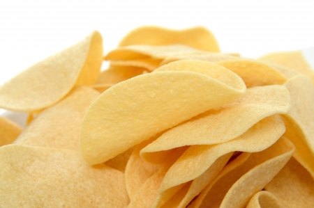 fat food: closeup of a pile of low fat potato chips