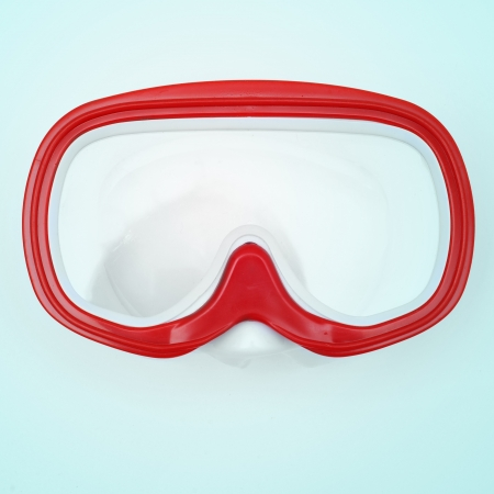 free diving: picture of a red and white diving mask, with a retro effect
