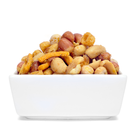 energy mix: a bowl with mixed nuts, such as roasted and salted peanuts, almonds or chickpeas on a white background  Stock Photo