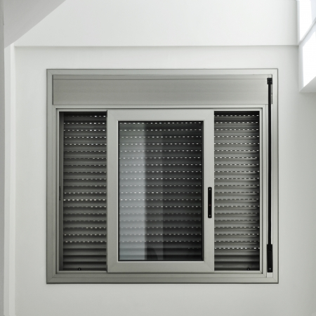 shutter: view of an aluminum sliding window with a roller shutter Stock Photo