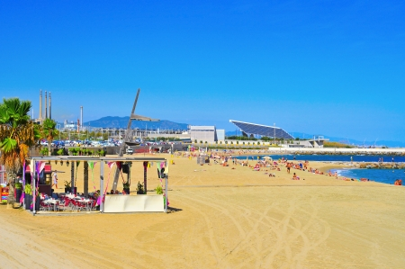 bella: Barcelona, Spain - September 16, 2013 La Nova Mar Bella beach in Barcelona, Spain  This beach, 420 meters long, arised with the urban redevelopment on the occasion of the 1992 Olympic Games Editorial
