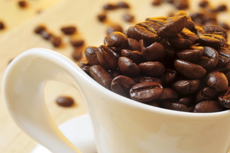 decaffeinated: closeup of a cup full of roasted coffee beans Stock Photo