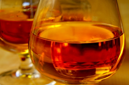 closeup of some cognac glasses with brandy photo