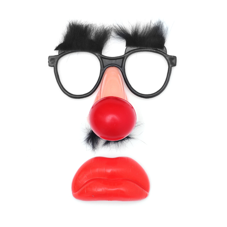 clown face: funny face: fake glasses and eyebrows, clown nose, mustache and mouth on a white background