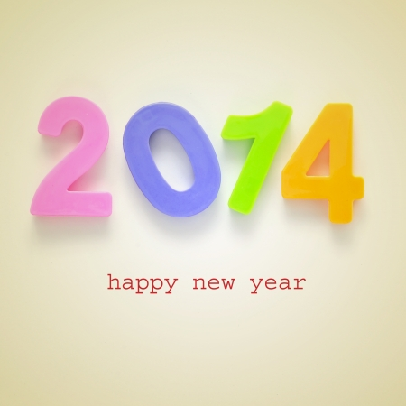 numbers 2014 and the sentence happy new year on a beige background, with a retro effect Stock Photo - 22501568