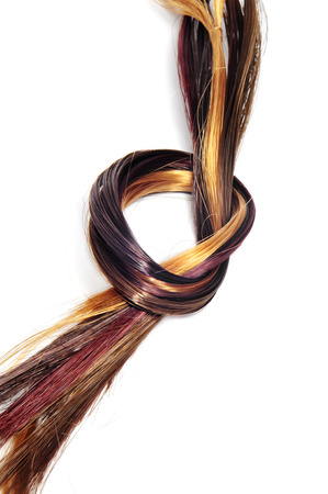 lock of hair of different colors on a white background photo