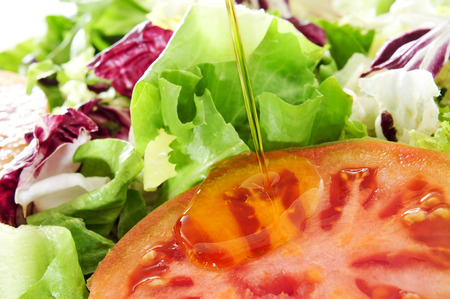 escarole: closeup of a plate with a green salad, with lettuce mix and tomato and olive oil Stock Photo