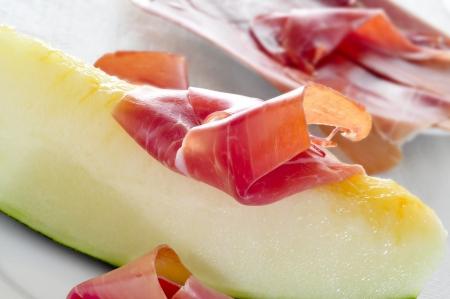 cured ham: spanish melon con jamon, melon with serrano ham, a typical dish in Spain Stock Photo