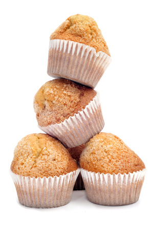 madalena: a pile of magdalenas, typical spanish plain muffins, on a white background Stock Photo