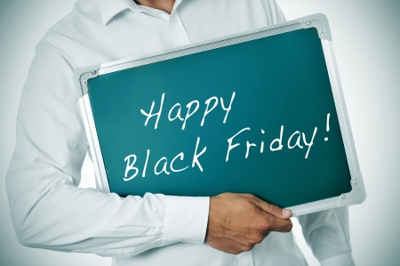 a man showing a blackboard with the sentence happy black friday written in it photo