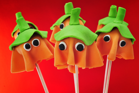 cake pops: some cake pops with the shape of ghost Halloween pumpkins