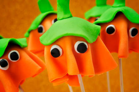 all seasons: some cake pops with the shape of ghost Halloween pumpkins