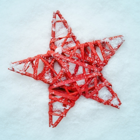 a christmas star on the snow with a retro effect photo