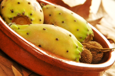 ficus: closeup of some prickly pear fruits in a earthenware bowl