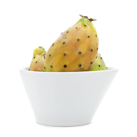 ficus: a bowl with prickly pear fruits on a white background