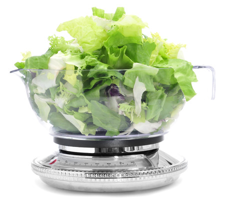 escarole: salad leaves in a scale, symbolizing the dieting concept or to stay fit