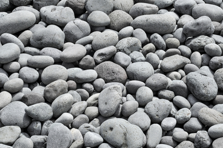background made of a closeup of a pile of pebbles in a shingle beach Stok Fotoğraf