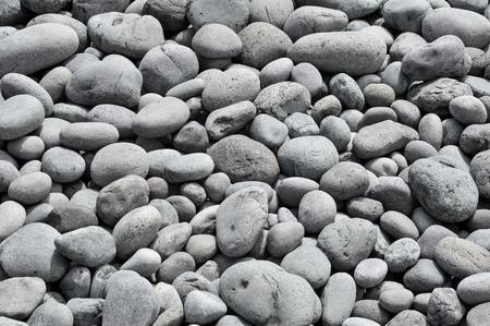 shingle beach: background made of a closeup of a pile of pebbles in a shingle beach Stock Photo