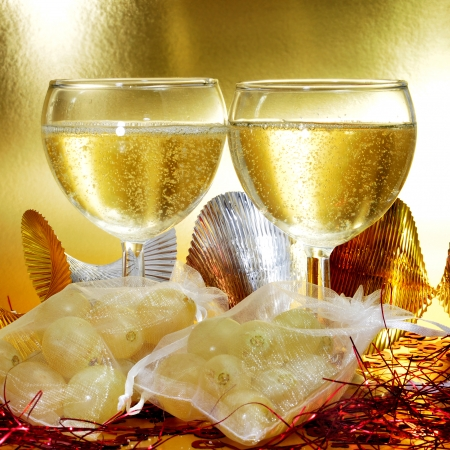 sachets: some glasses with spanish champagne and sachets with the twelve grapes of luck, traditional on the New Year