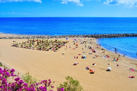 Maspalomas, Spain - October 9, 2013  Playa del Ingles beach in Maspalomas, Gran Canaria, Canary Islands, Spain  This is an important winter tourist destination for many europeans Stock Photo - 23141298