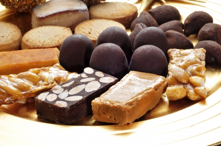 closeup of a tray with turron, mantecados and polvorones, typical christmas sweets in Spain photo