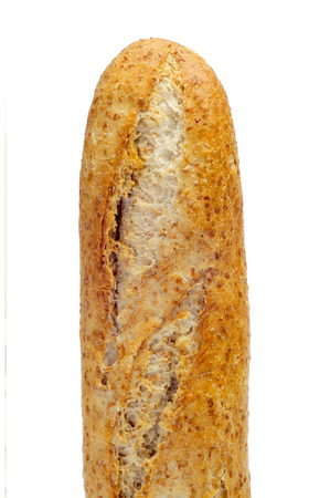 closeup of a whole wheat baguette on a white background