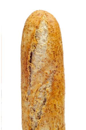 panino: primer plano de una barra de pan de trigo entero sobre un fondo blanco