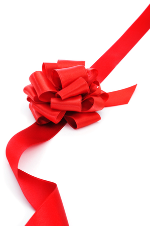 a red ribbon with a bow on a white background with a blank copy-space photo