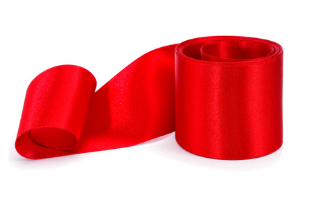 a roll of red satin ribbon bow on a white background photo