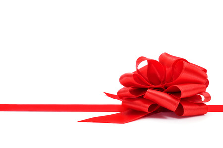 a red ribbon with a bow on a white background with a blank copy-space Stock Photo - 23307456