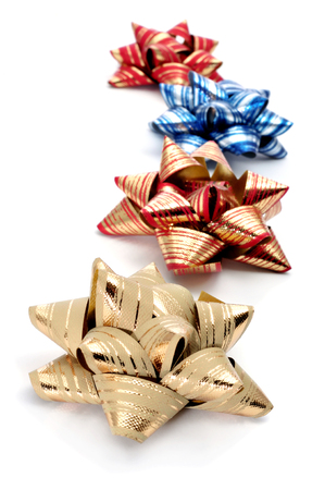 some gift ribbon bows of different colors on a white background photo