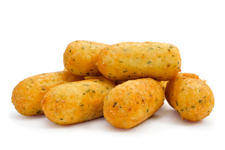 cod: a pile of croquetas de bacalao, spanish codfish croquettes, on a white background