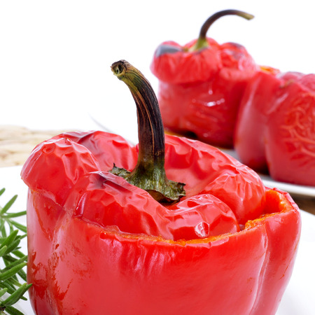 bell peppers: closeup of some stuffed red bell peppers on a white background Stock Photo