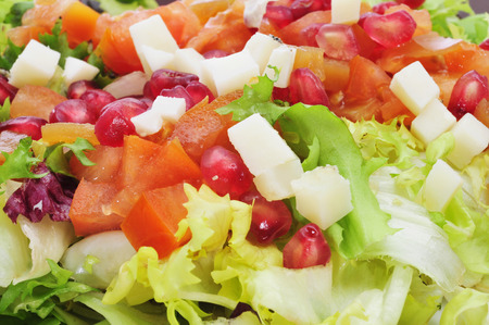 cornsalad: closeup of a salad with tomato, pomegranate fruit and cheese