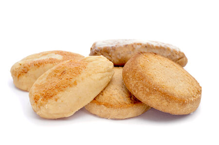 closeup of some mantecados and polvorones, typical christmas sweets in Spain, on a white background photo