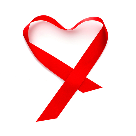 satin ribbon: a red satin ribbon forming a heart on a white background