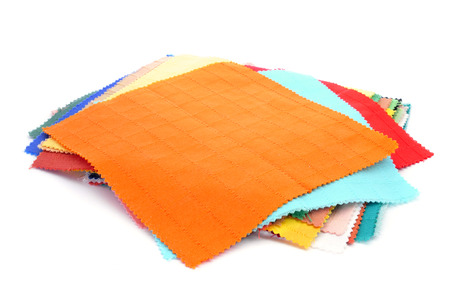 rags: square pieces of fabric with different colors and patterns on a white  Stock Photo