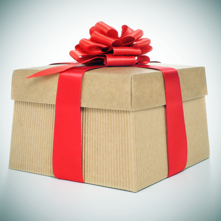 picture of a gift with a red ribbon, with a retro effect photo