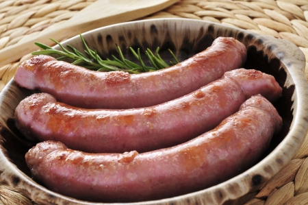 llonganissa: closeup of a plate with some barbecued pork meat sausages