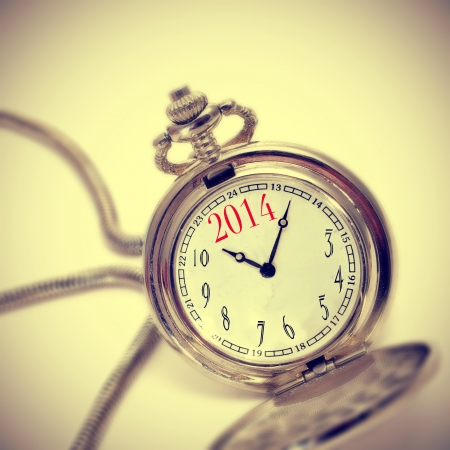 0 1 years: picture of a pocket watch with the number 2014, as the new year, in the dial, with a retro effect