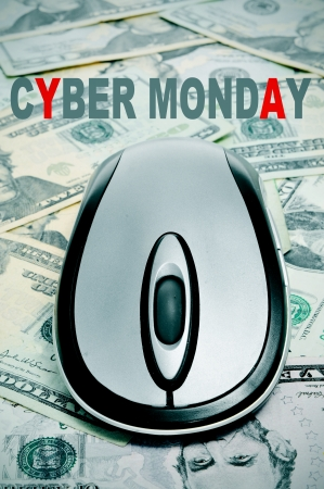 the sentence cyber monday and a computer mouse on a background full of dollar banknotes photo