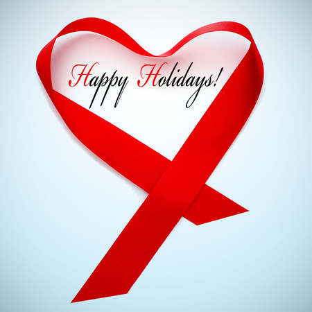 a red satin ribbon forming a heart and the sentence happy holidays photo