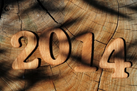 two thousand and fourteen: 2014, as the new year, written with wooden numbers on a wooden surface