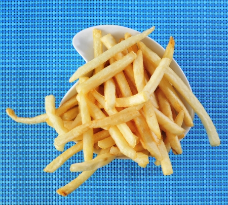 frites: a bowl with appetizing french fries on a set table