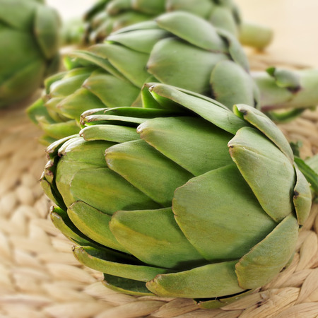 closeup of a pile of raw artichokes photo