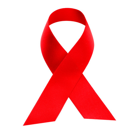 a red ribbon for the fight against AIDS on a white background photo